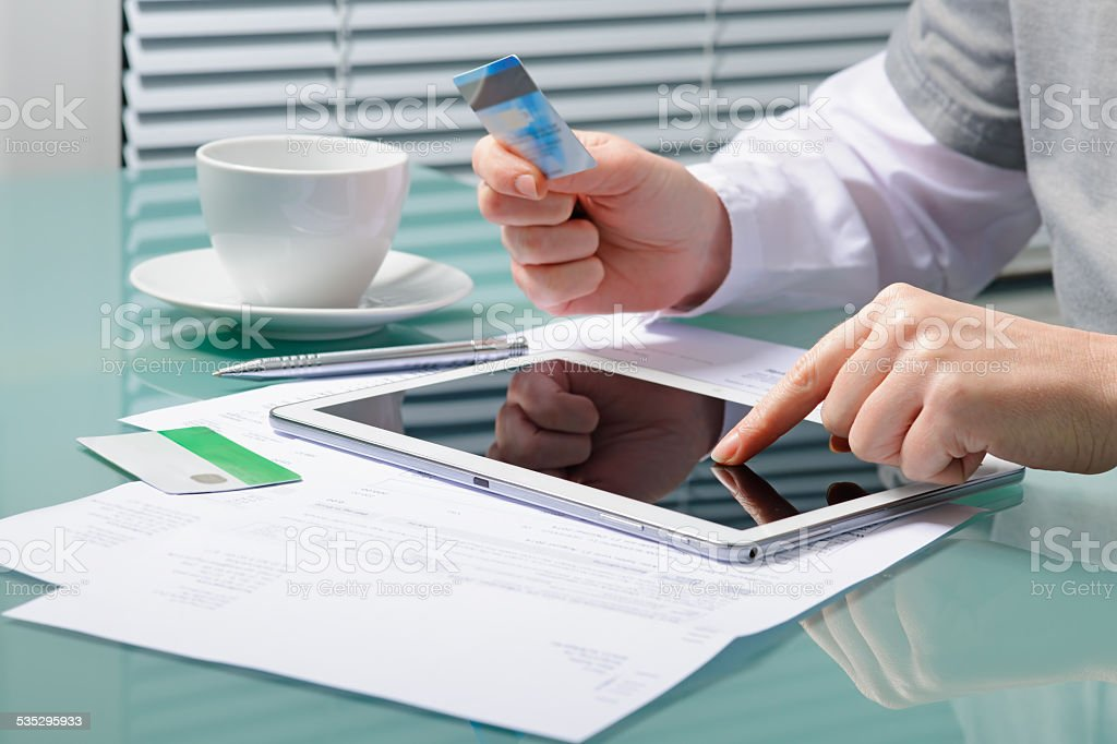 Woman is shopping online with tablet pc stock photo