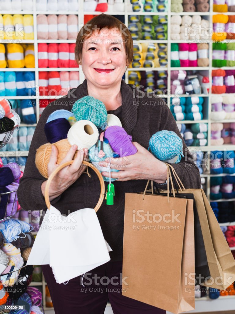 Woman is standing with purchases stock photo