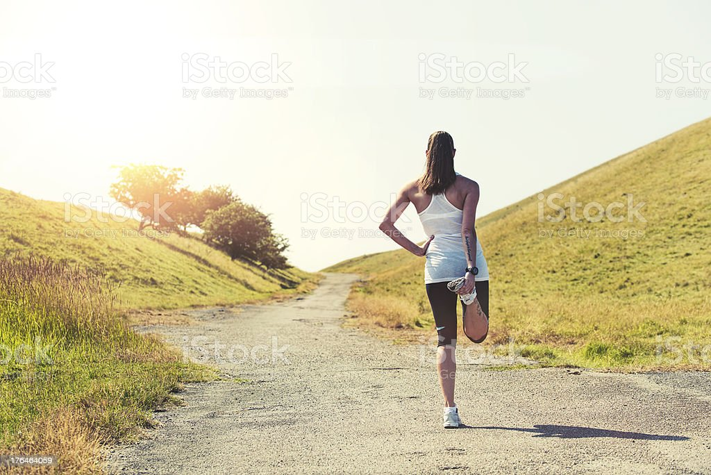 Woman is stretching before going for a run stock photo
