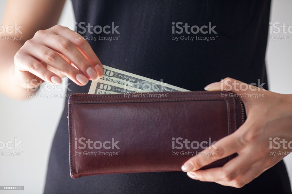 Woman is taking out money from wallet