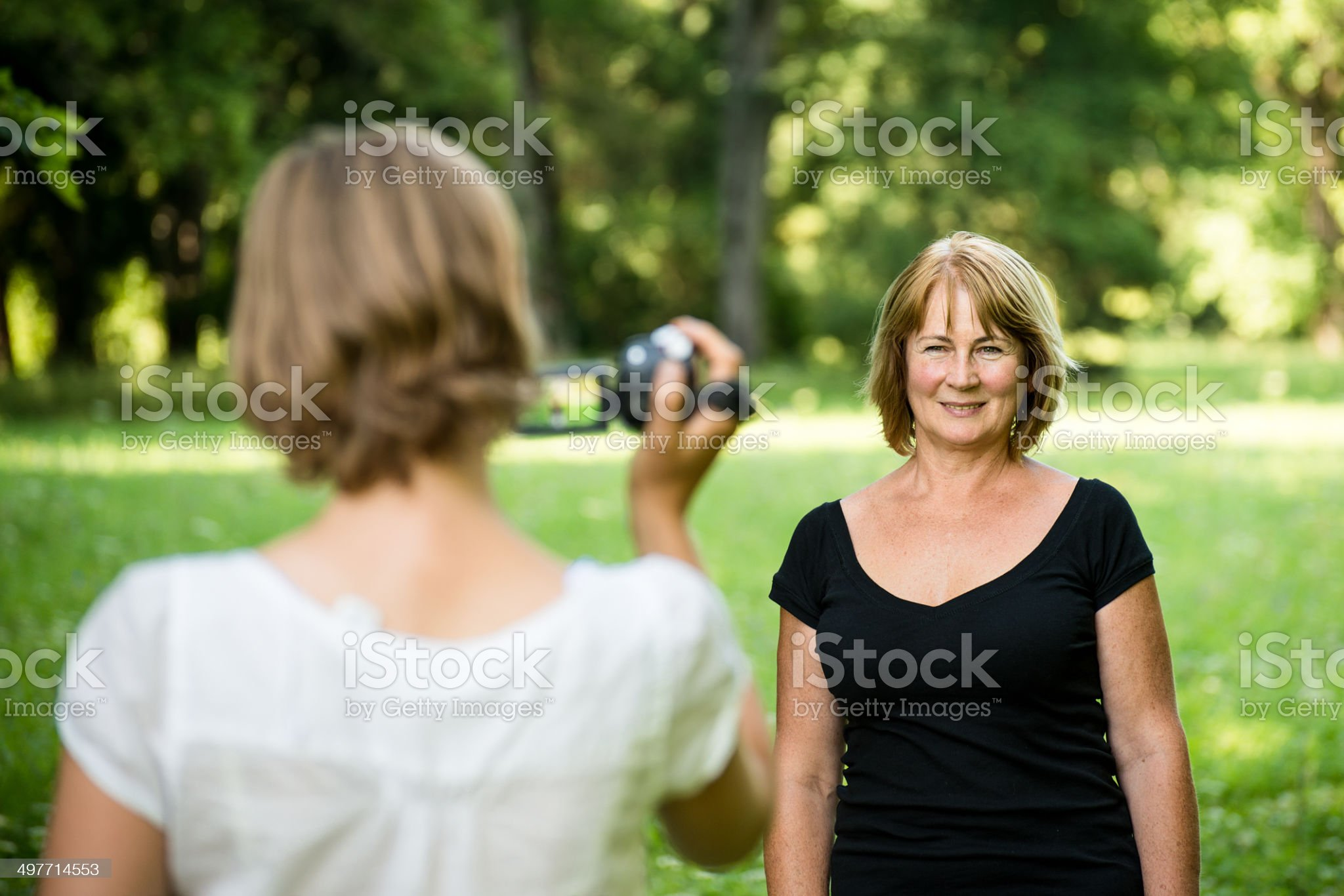 Woman is taking video of her mother royalty-free stock photo