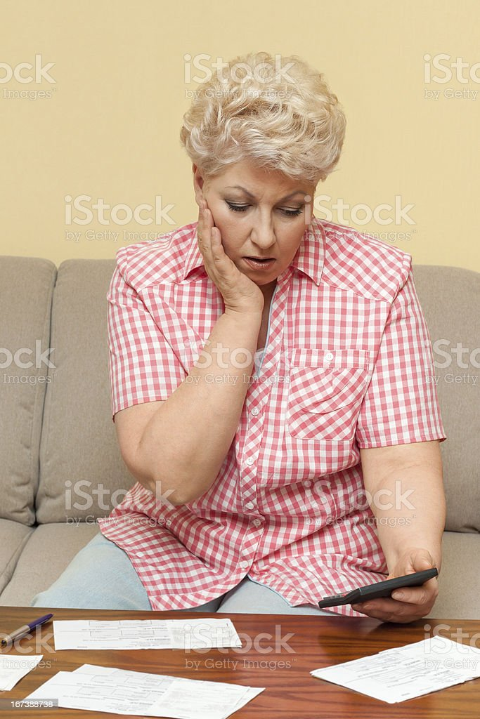 woman is upset and afflicted her debts royalty-free stock photo