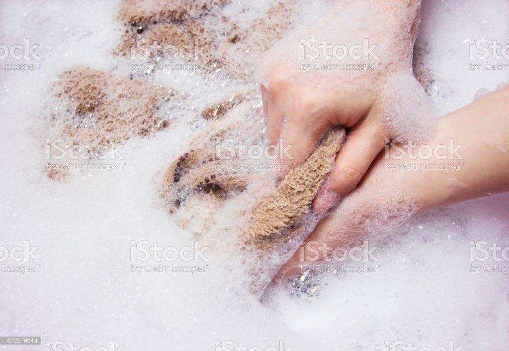 Woman is washing towel stock photo
