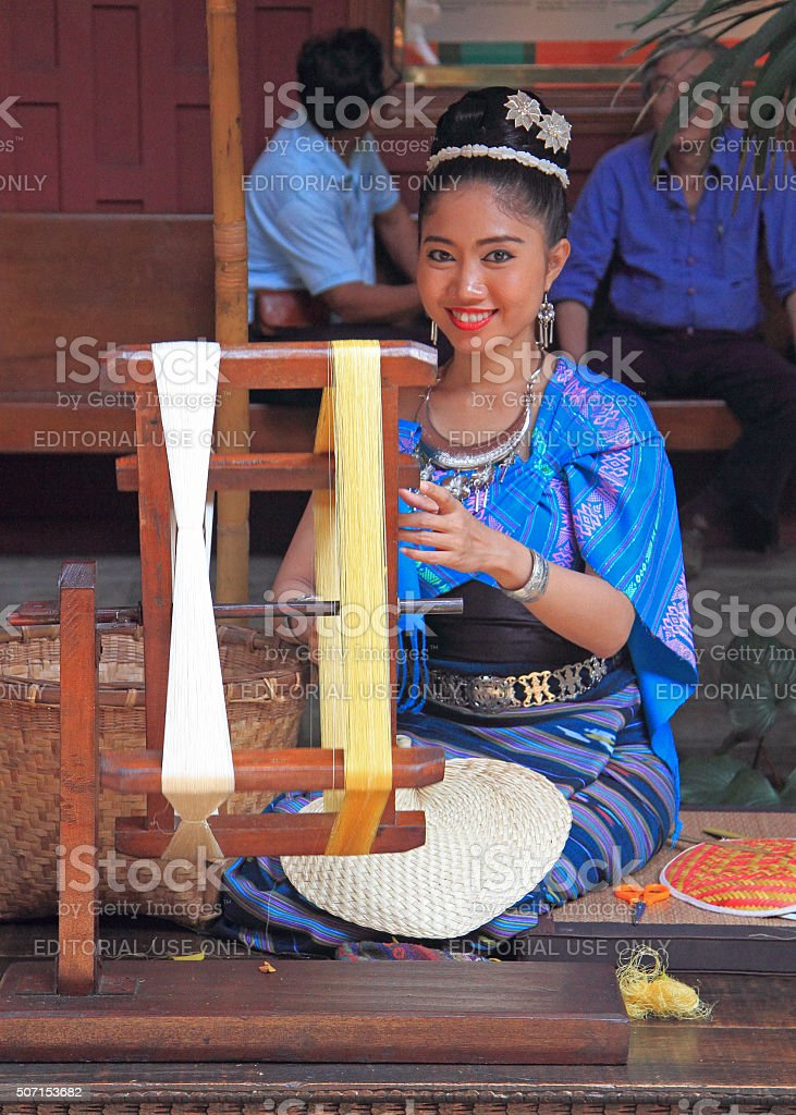 woman is weaving outdoor, Bangkok, Thailand stock photo