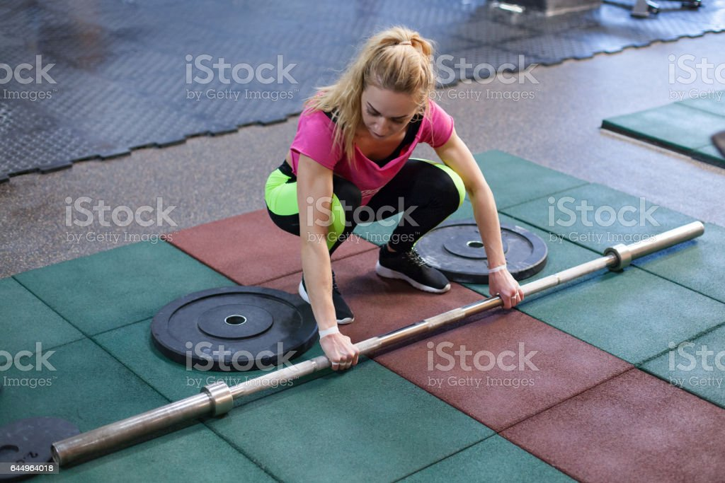 woman is working with the barbell stock photo