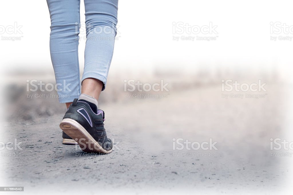 Woman jeans and sneaker shoes stock photo