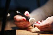 Woman Jeweller prepare a silver ring to polishing.