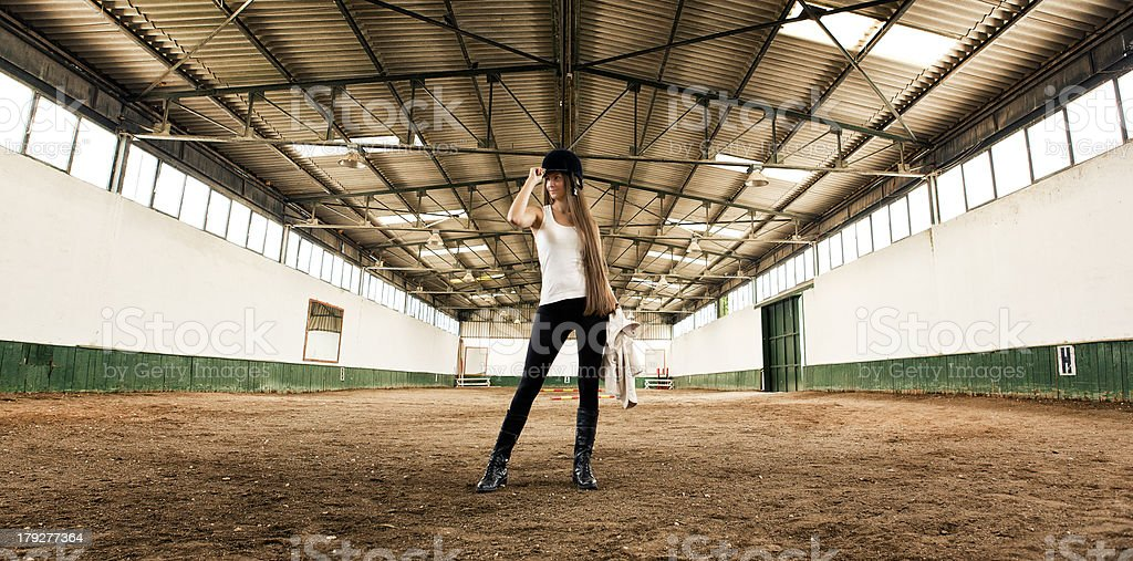 woman Jockey standing Indoor Horse Arena royalty-free stock photo