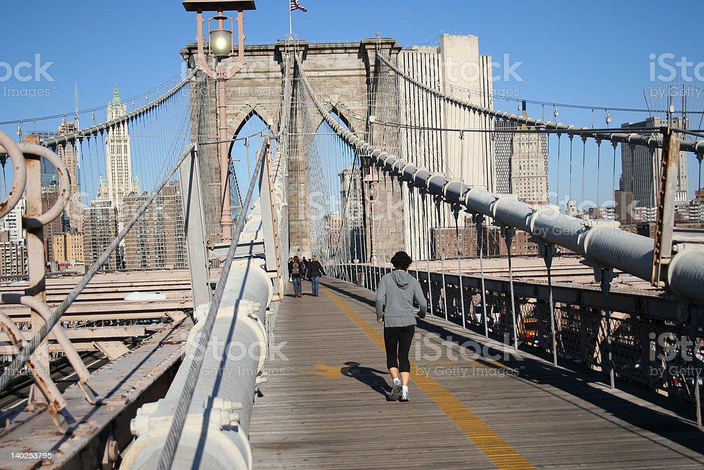 woman jogging towards New York royalty-free stock photo