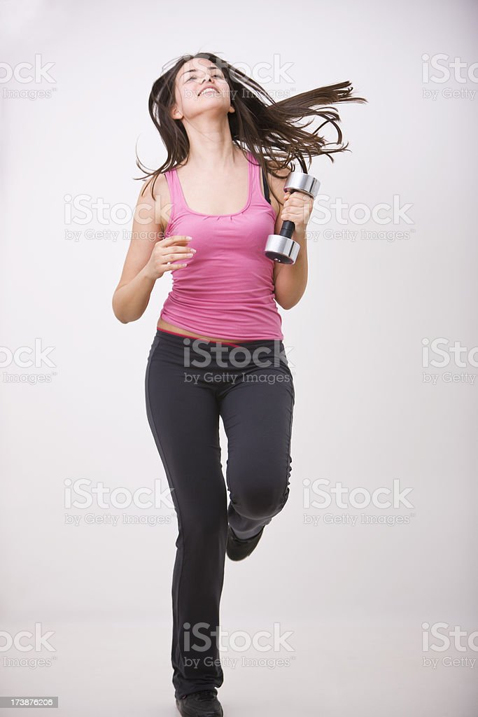 Woman Jogging With Dumbbell royalty-free stock photo