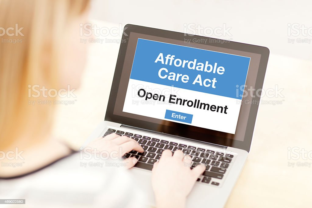 Woman Joining Affordable Care Act ObamaCare Open Enrollment Online stock photo