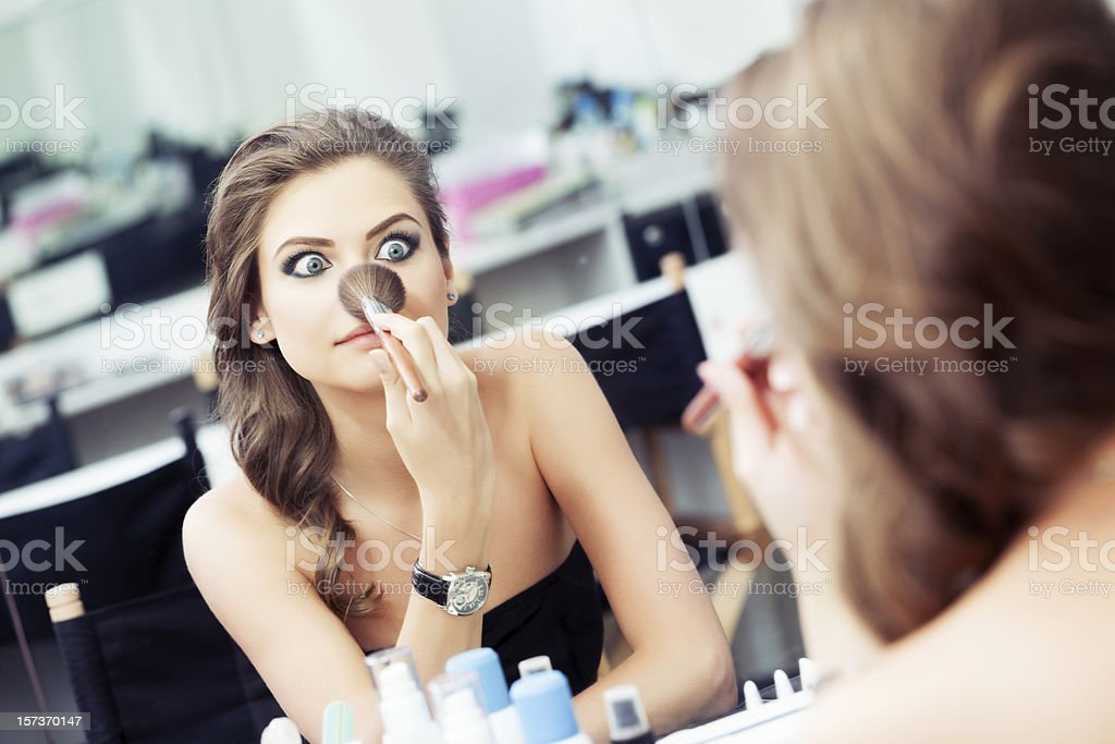 Woman joking in front of a mirror royalty-free stock photo