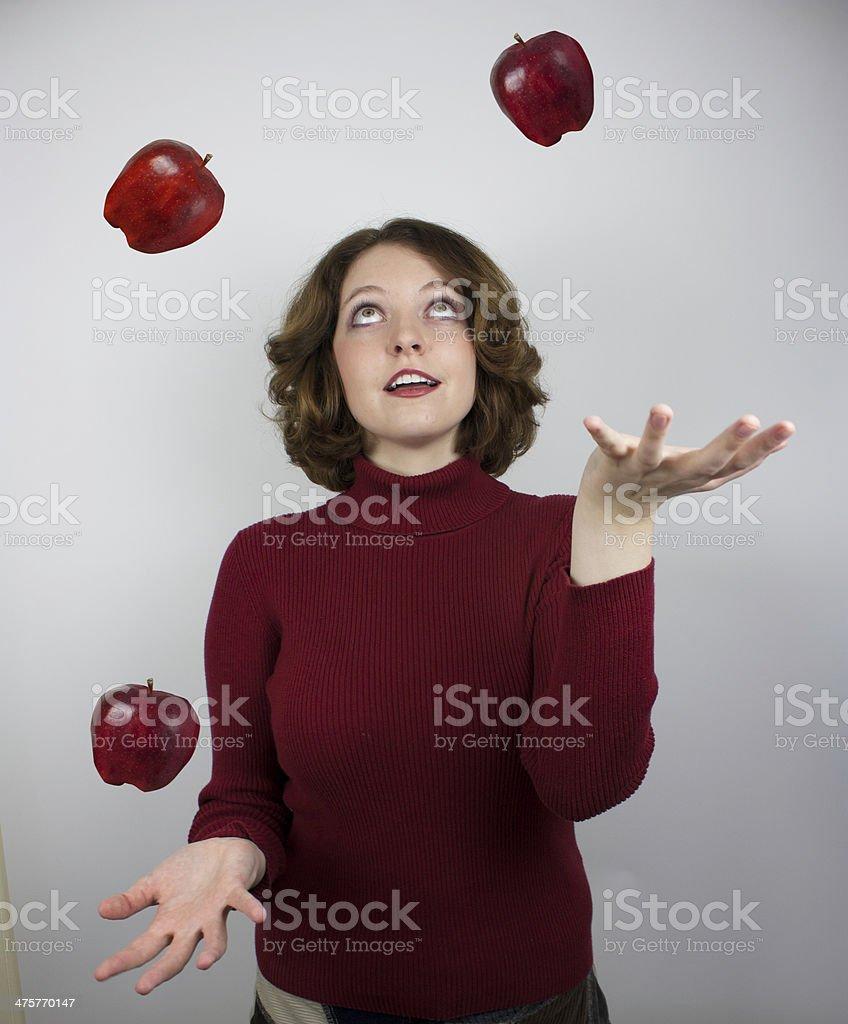 Woman juggling apples stock photo