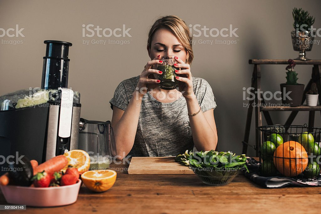 Woman juicing with fresh fruit stock photo