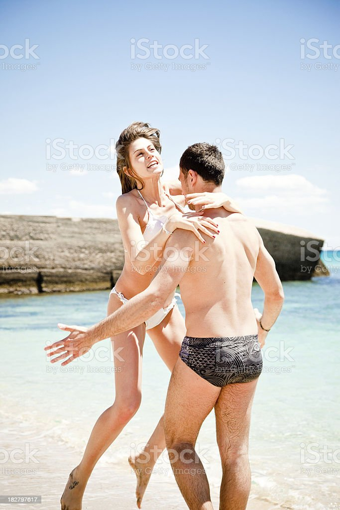 Woman Jumping Astride On His Boyfriend royalty-free stock photo