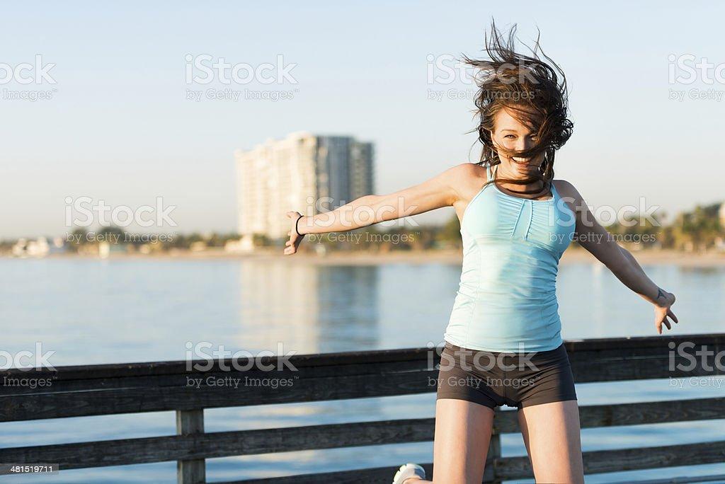Woman Jumping Before Running stock photo