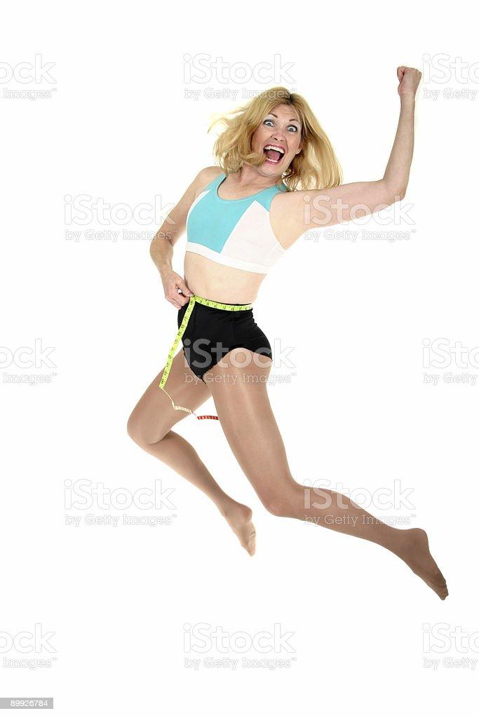 Woman Jumping for Joy at Weight Loss royalty-free stock photo