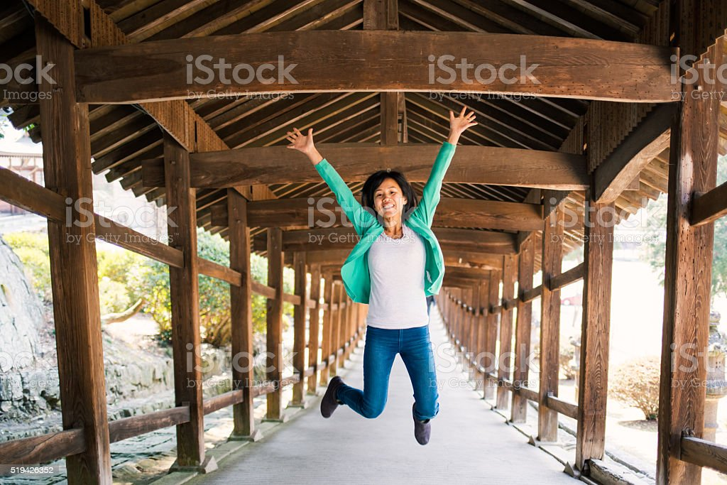 Woman jumping for joy stock photo
