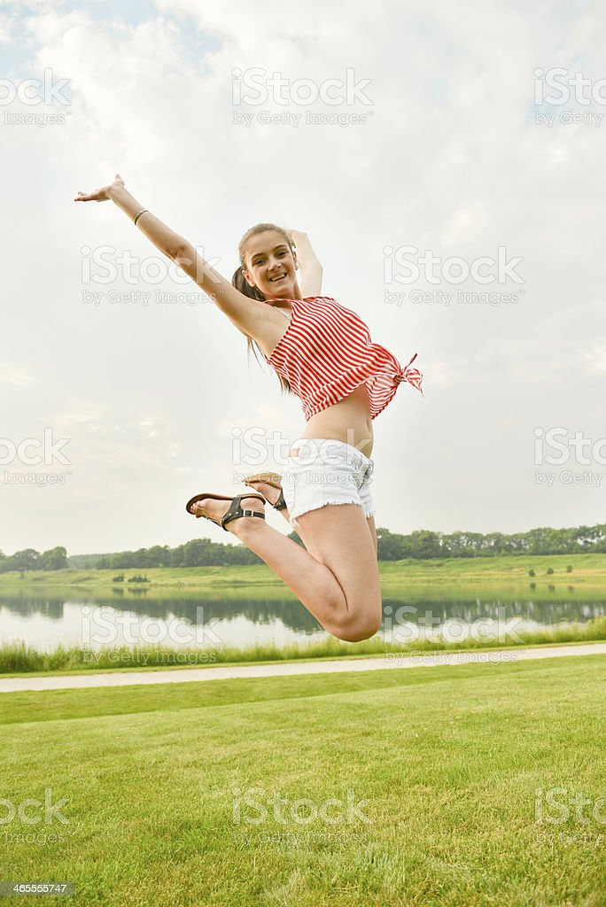 Woman Jumping for Success stock photo