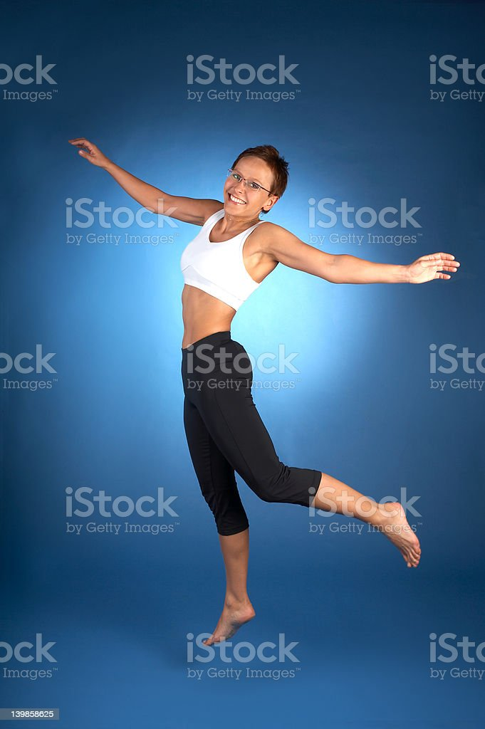 Woman jumping in air stock photo