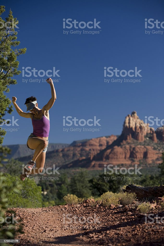 Woman jumping in desert royalty-free stock photo