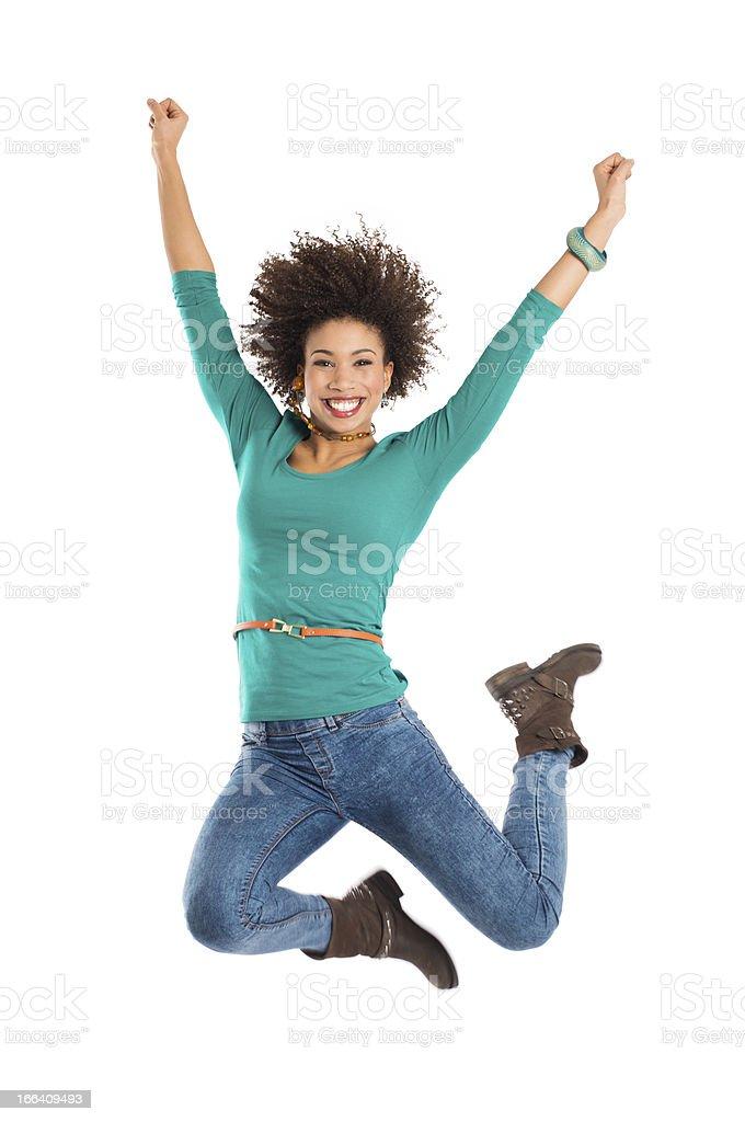 Woman Jumping In Joy stock photo