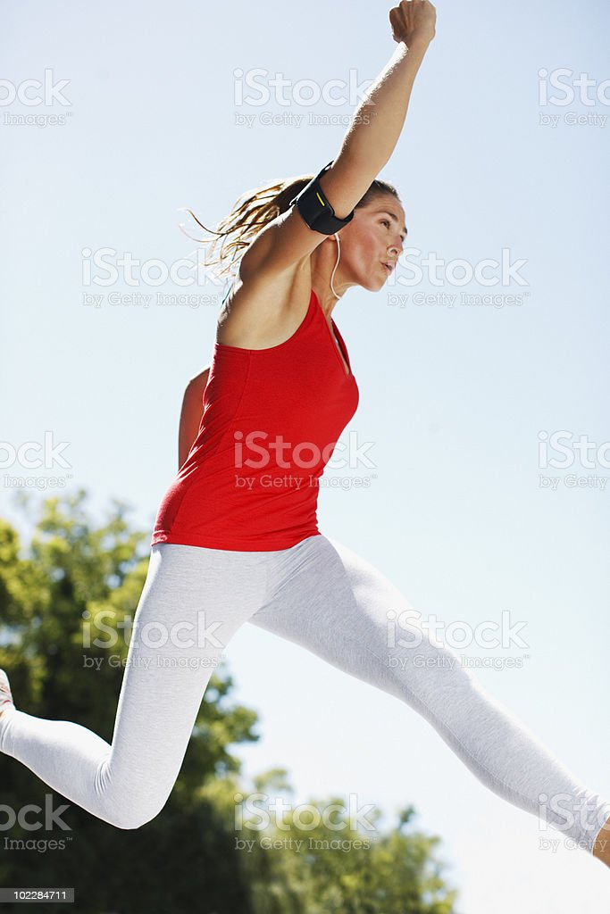 Woman jumping in mid-air royalty-free stock photo