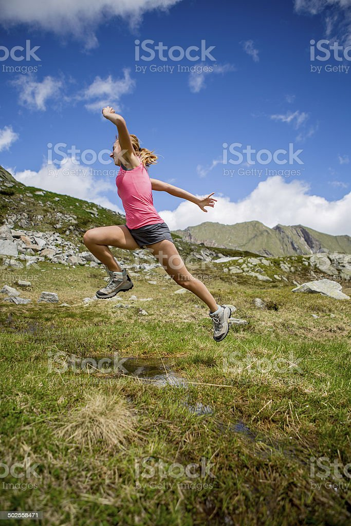 Woman jumping in nature stock photo