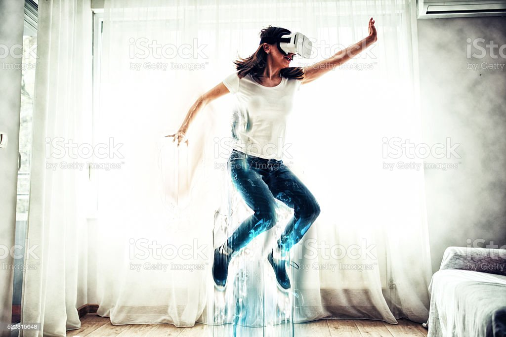 Woman jumping in virtual world stock photo