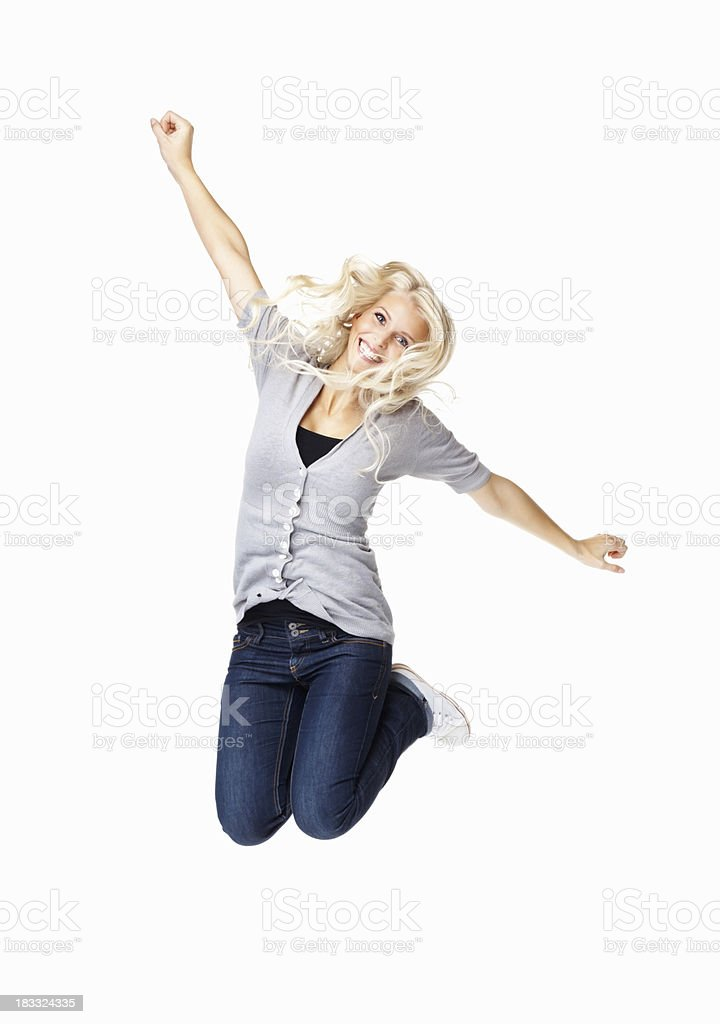 A woman jumping into the air with her hands up stock photo