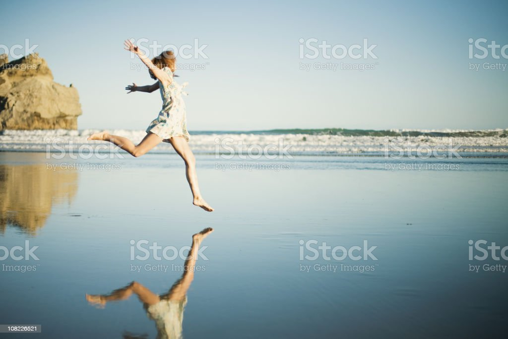 Woman Jumping on Beach royalty-free stock photo