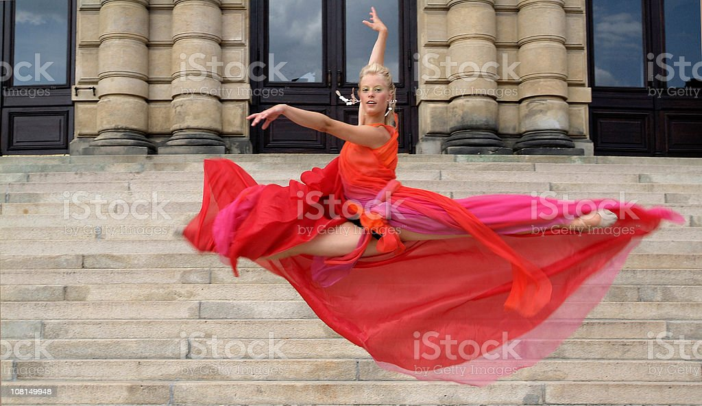 Woman Jumping on Staircase stock photo