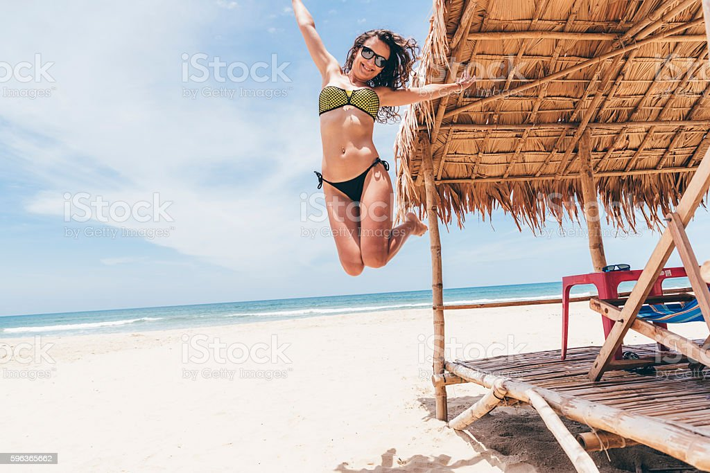 Woman Jumping On The Beach. stock photo