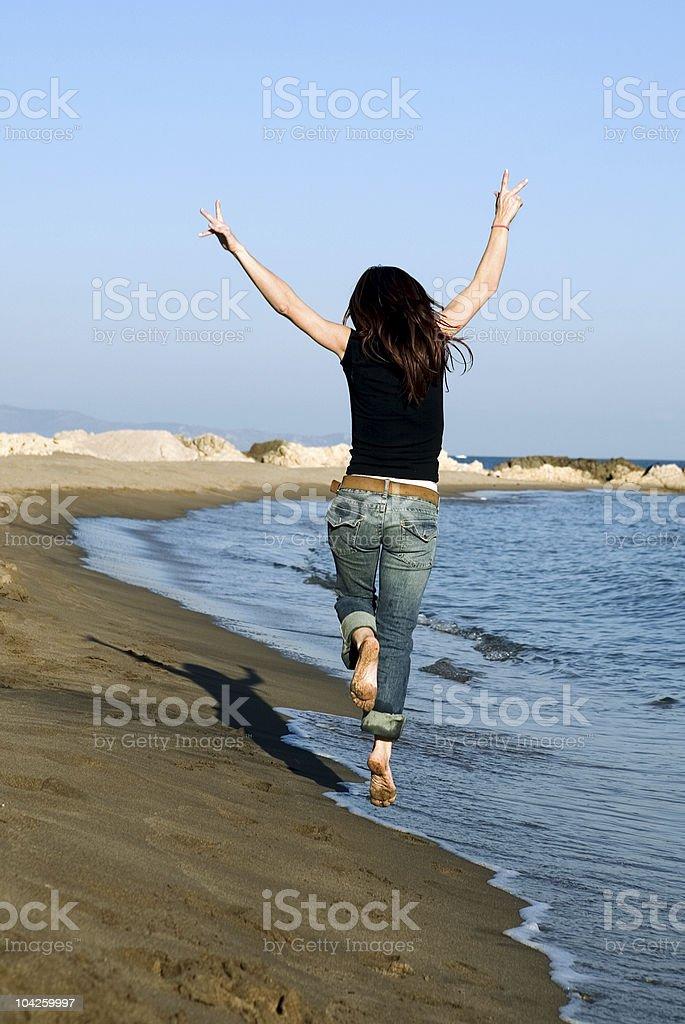 Woman jumping royalty-free stock photo