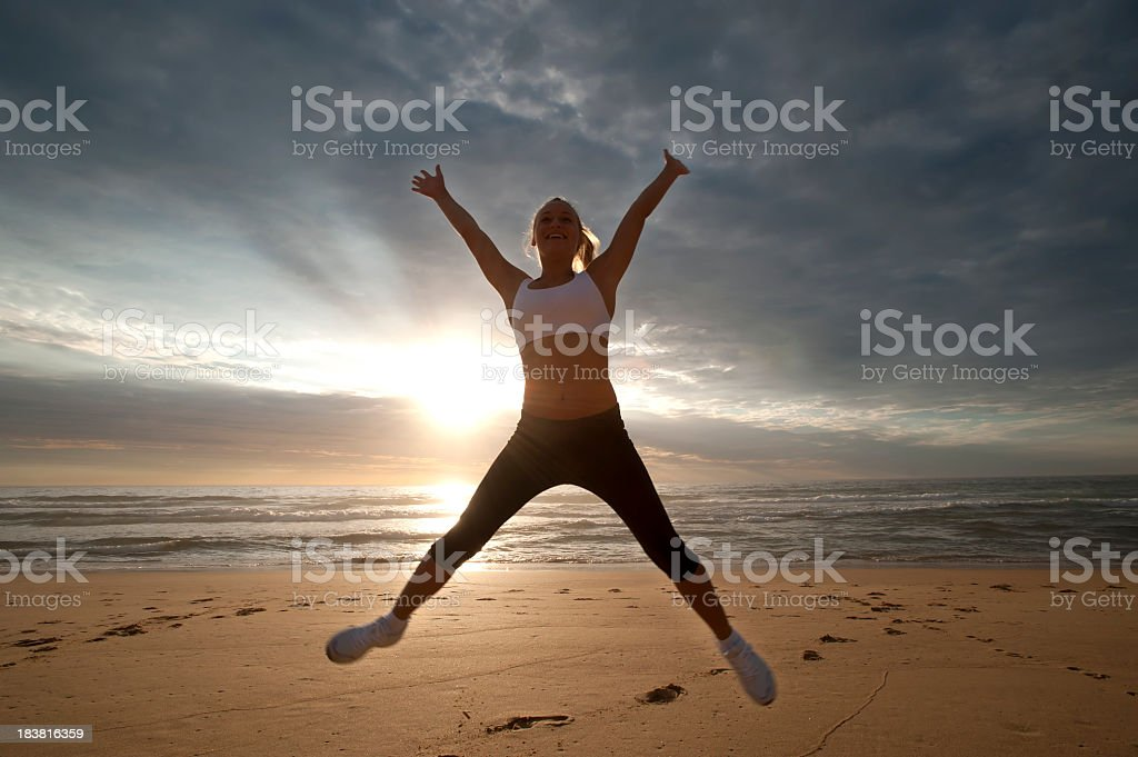 Woman jumping stock photo