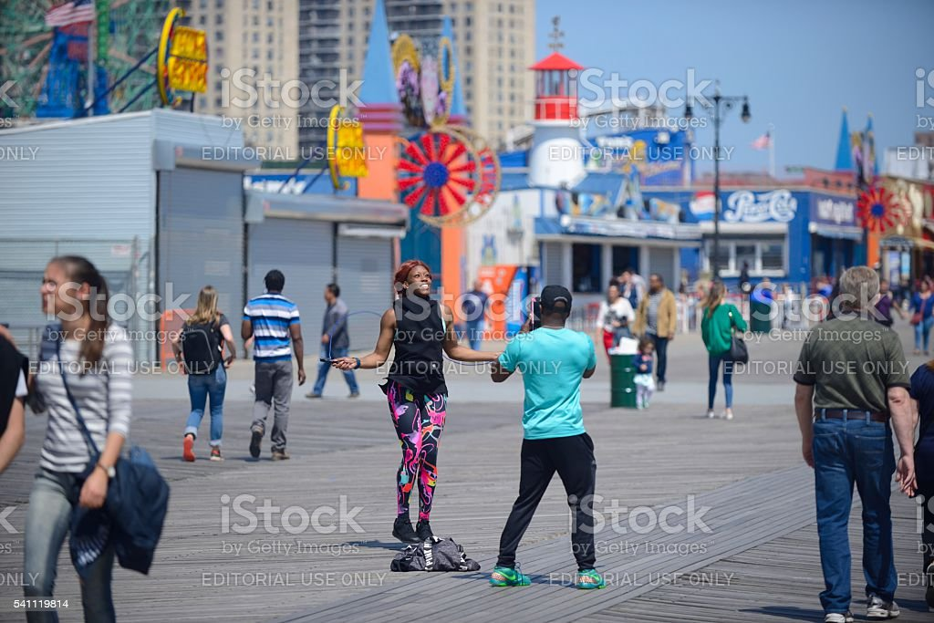 Woman jumping rope on the Coney Island Boardwalk stock photo