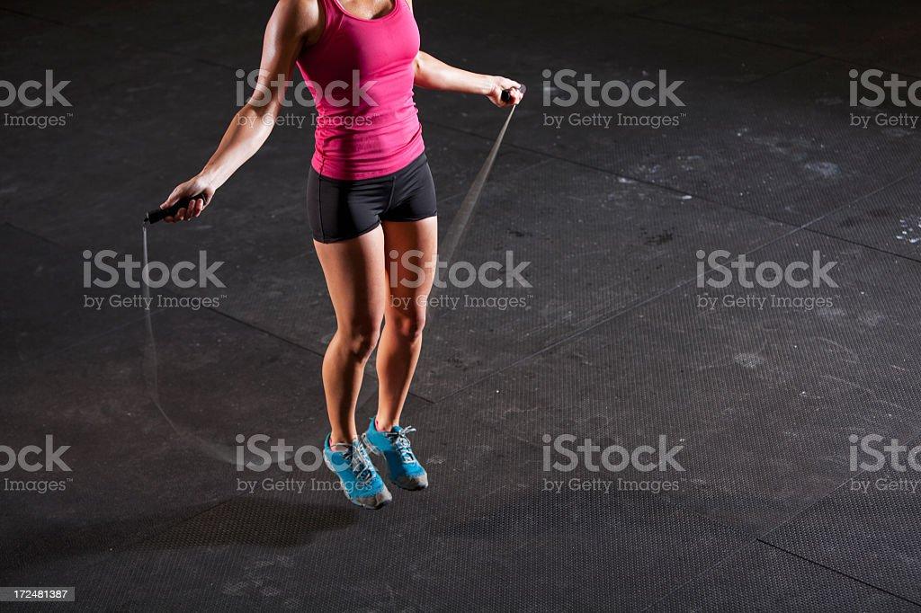 Woman jumping rope royalty-free stock photo