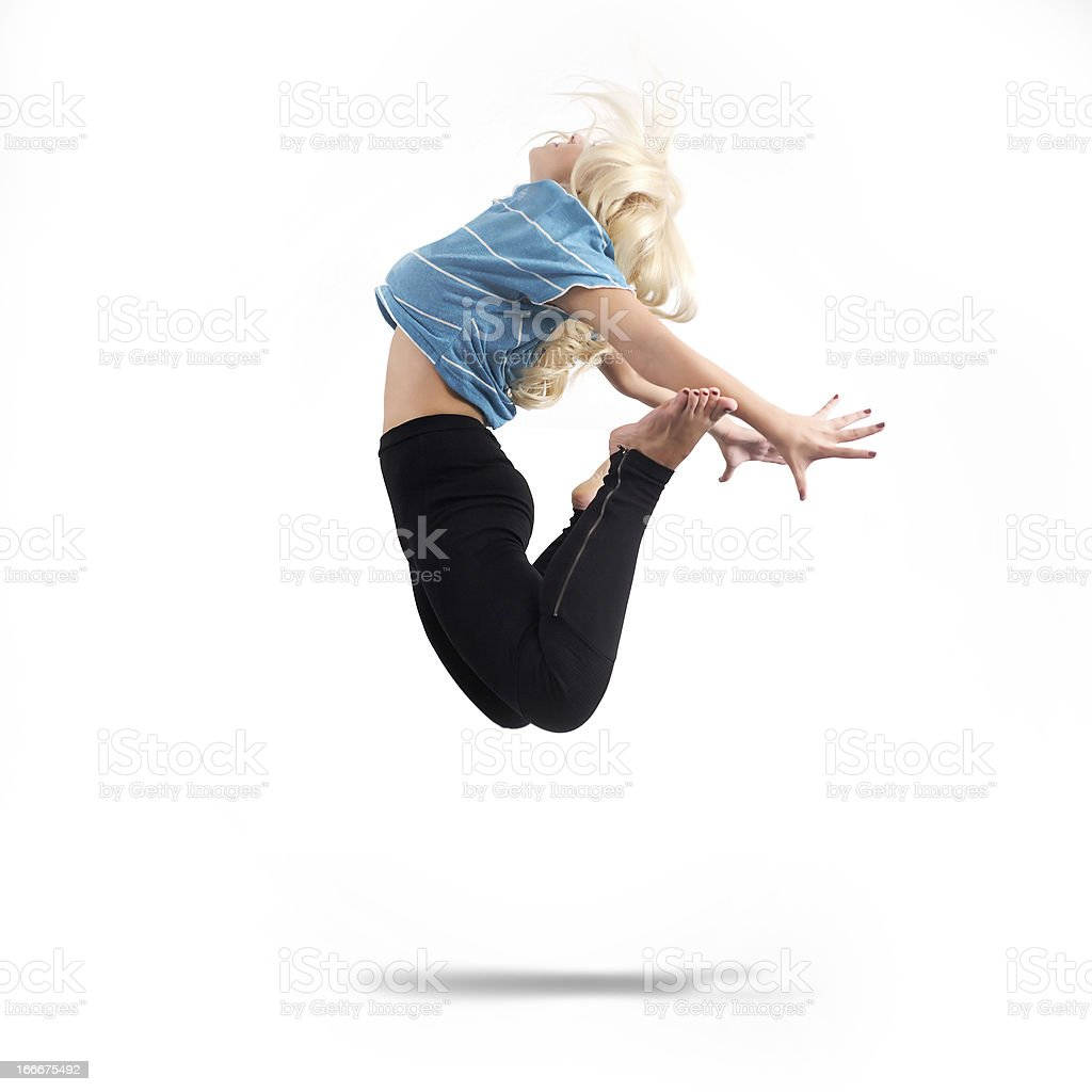 Woman jumping. Studio shot royalty-free stock photo