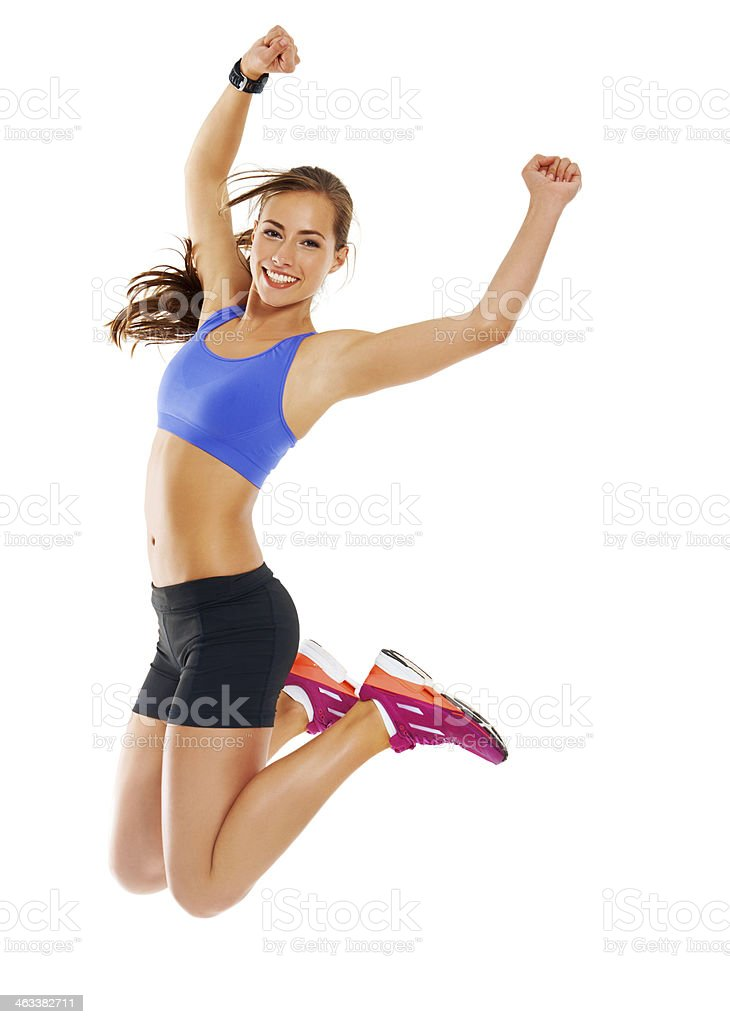Woman jumping up with energy stock photo