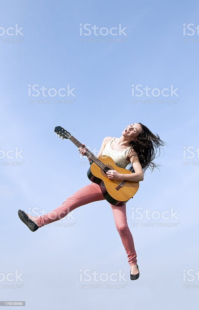 woman jumping with guitar royalty-free stock photo
