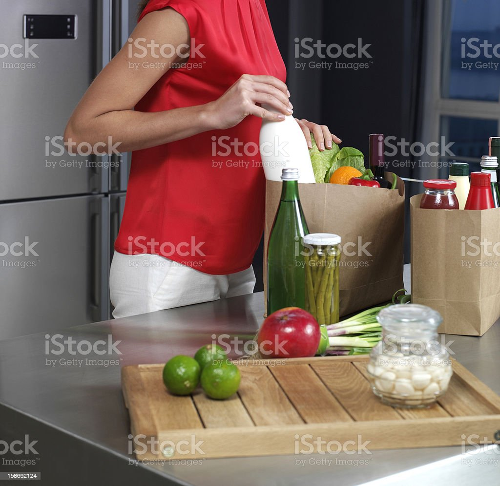 Woman just returned from supermarket stock photo