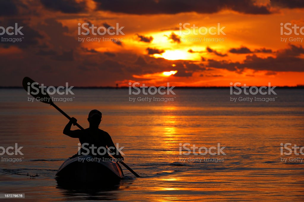 woman kayaking during sunset in Florida Keys royalty-free stock photo