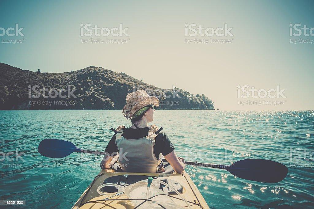 Woman Kayaking in Abel Tasman National Park, New Zealand stock photo