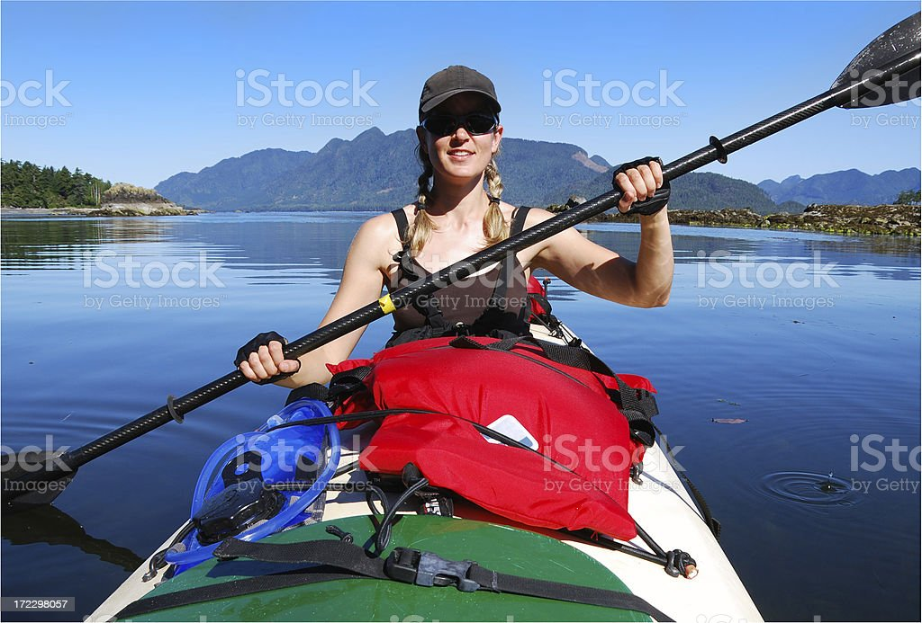 Woman kayaking in Canada stock photo