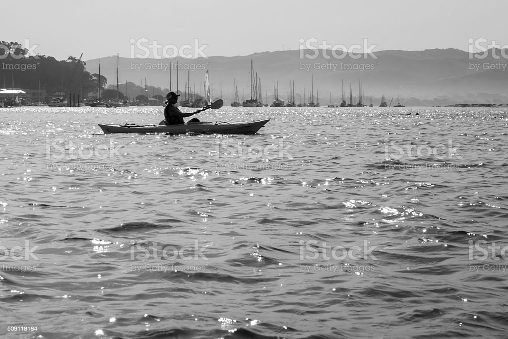 Woman kayaking in Morro Bay stock photo