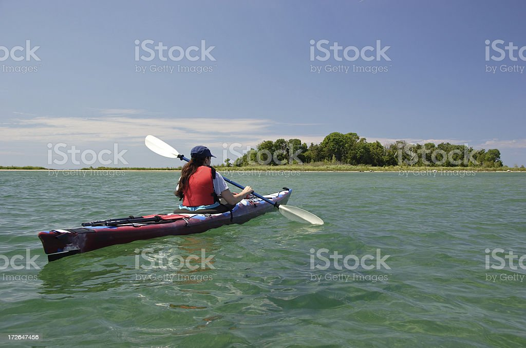 Woman Kayaking On Sunny Day stock photo