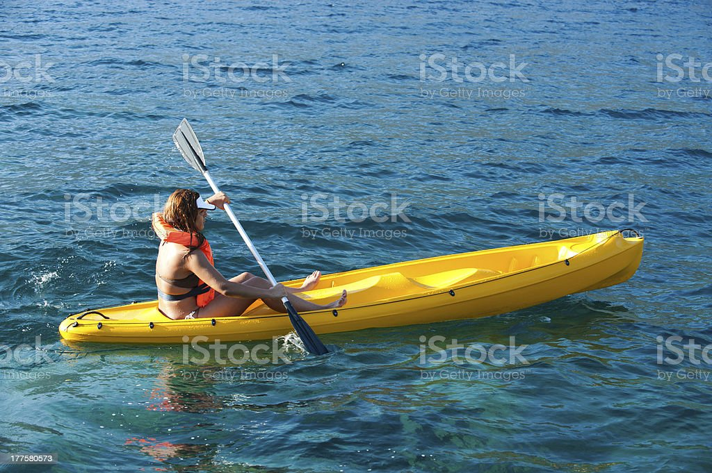 Woman kayaks on the sea royalty-free stock photo