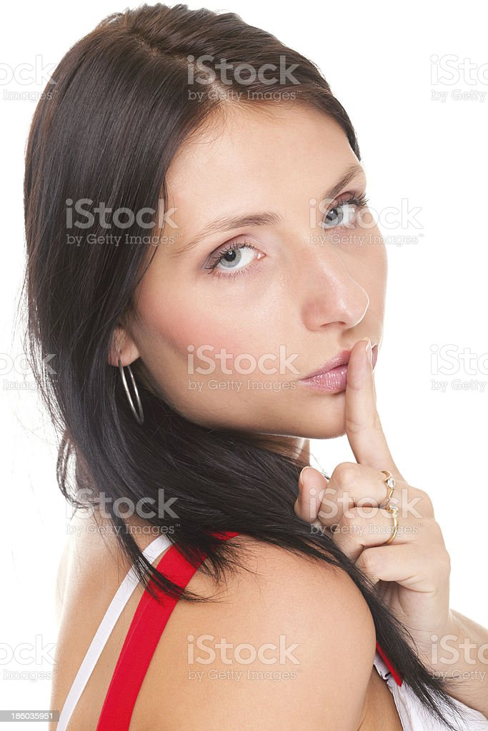 Woman keep quiet gesture finger on mouth isolated stock photo