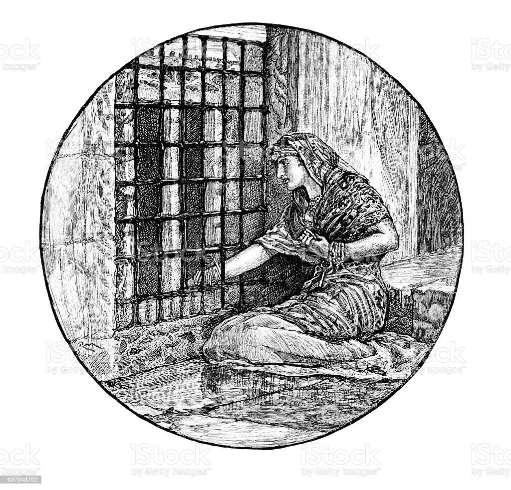 Woman kept in a prison cell stock photo