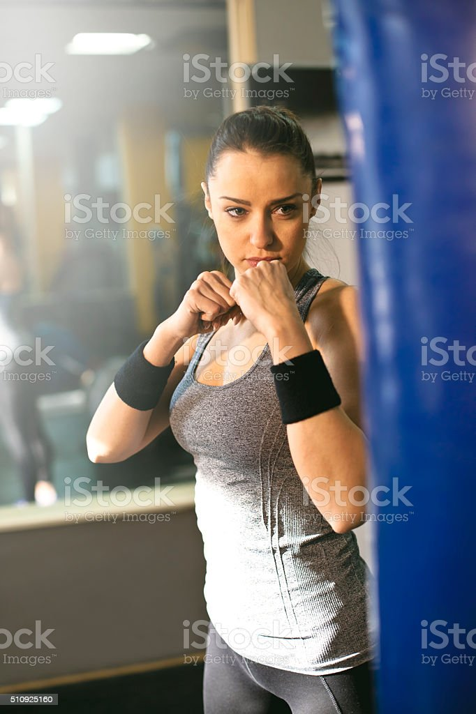 woman kick the heavy bag stock photo